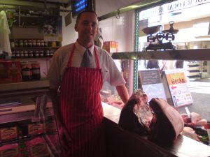 Paul in the shop with a side of Welsh Black beef