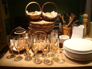 all organised: bread in baskets, champagne flutes ready and plates to be warmed