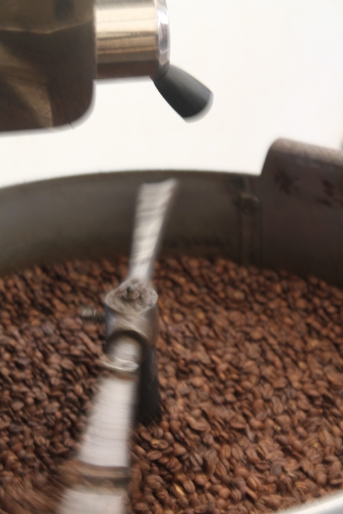 once the beans reach the desired level of roast they are released from the drum into the bottom container to cool